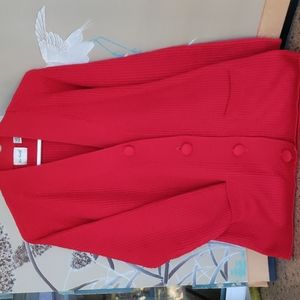 Red, ribbed acrylic cardigan with 2 front pockets.